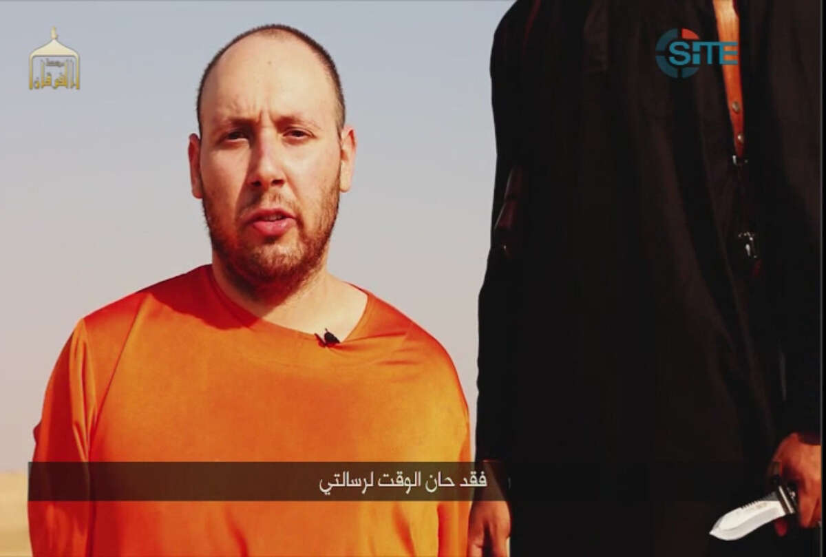 """The SITE Intelligence Group, a U.S. terrorism watchdog, provided this video posted on the Internet by Islamic State militants. In Arabic at the bottom it says, """"Now is the time for my message."""" """"There is no credible intelligence to suggest that there is an active plot by ISIL [ISIS] to attempt to cross the southern border,"""" Homeland Security officials said in a written statement to The New York Times."""