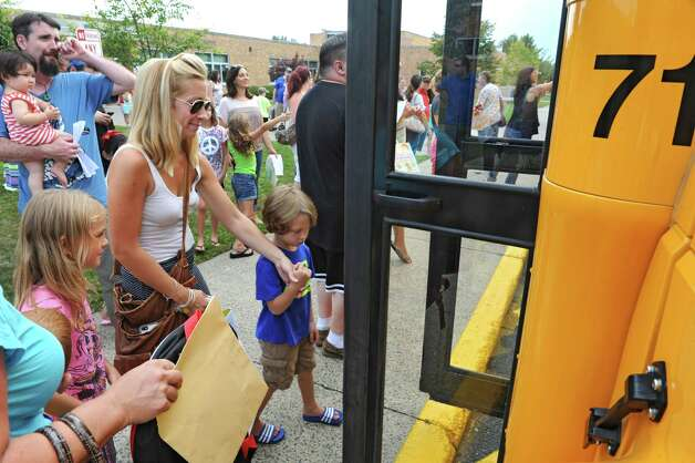 Kindergarten students board a school bus for a test ride at Gardner-Dickinson School on Tuesday, Sept. 2, 2014 in North Greenbush, N.Y. Parents brought their kindergarten students to drop off school supplies, meet their teachers and take a quick bus ride. (Lori Van Buren / Times Union) Photo: Lori Van Buren / 00028410A