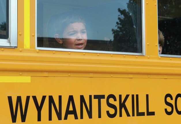 Anthony Vazzana, 4, of Wynantskill looks out the window at his mom and cries a little as kindergarten students take a test ride on a school bus at Gardner-Dickinson School on Tuesday, Sept. 2, 2014 in North Greenbush, N.Y. Parents brought their kindergarten students to drop off school supplies, meet their teachers and take a quick bus ride. (Lori Van Buren / Times Union) Photo: Lori Van Buren / 00028410A