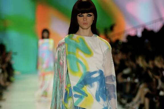 Academy of Art designer Yuko Okudaira showed her graduate fashion collection May 8 at the Graduation Fashion Show and Awards Ceremony. She used solely white cotton twill, polyester mesh, and lycra knit jersey, which was spray-painted by her collaborator and graffiti artist Liang Huo.