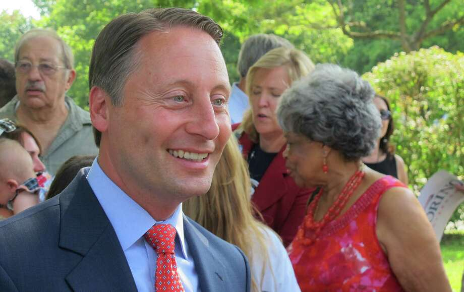 Rob Astorino, the Republican candidate for governor of New York, speaks with supporters after a news conference in Hawthorne, N.Y., on Tuesday, Sept. 2, 2014. Astorino said the Board of Regents, which supervises the state's schools, should be chosen by the people rather than the Legislature. (AP Photo/Jim Fitzgerald) ORG XMIT: RPJF103 Photo: Jim Fitzgerald / AP