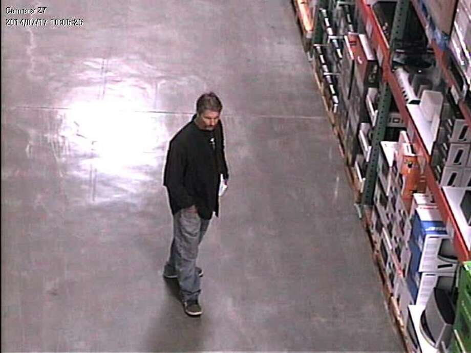 "Santa Cruz police are asking the public for help in identifying a thief who officers have nicknamed ""El Mustachio the Magician."" Surveillance video caught this image of him during his second heist, July 17. Photo: Courtesy, Santa Cruz Police Department"