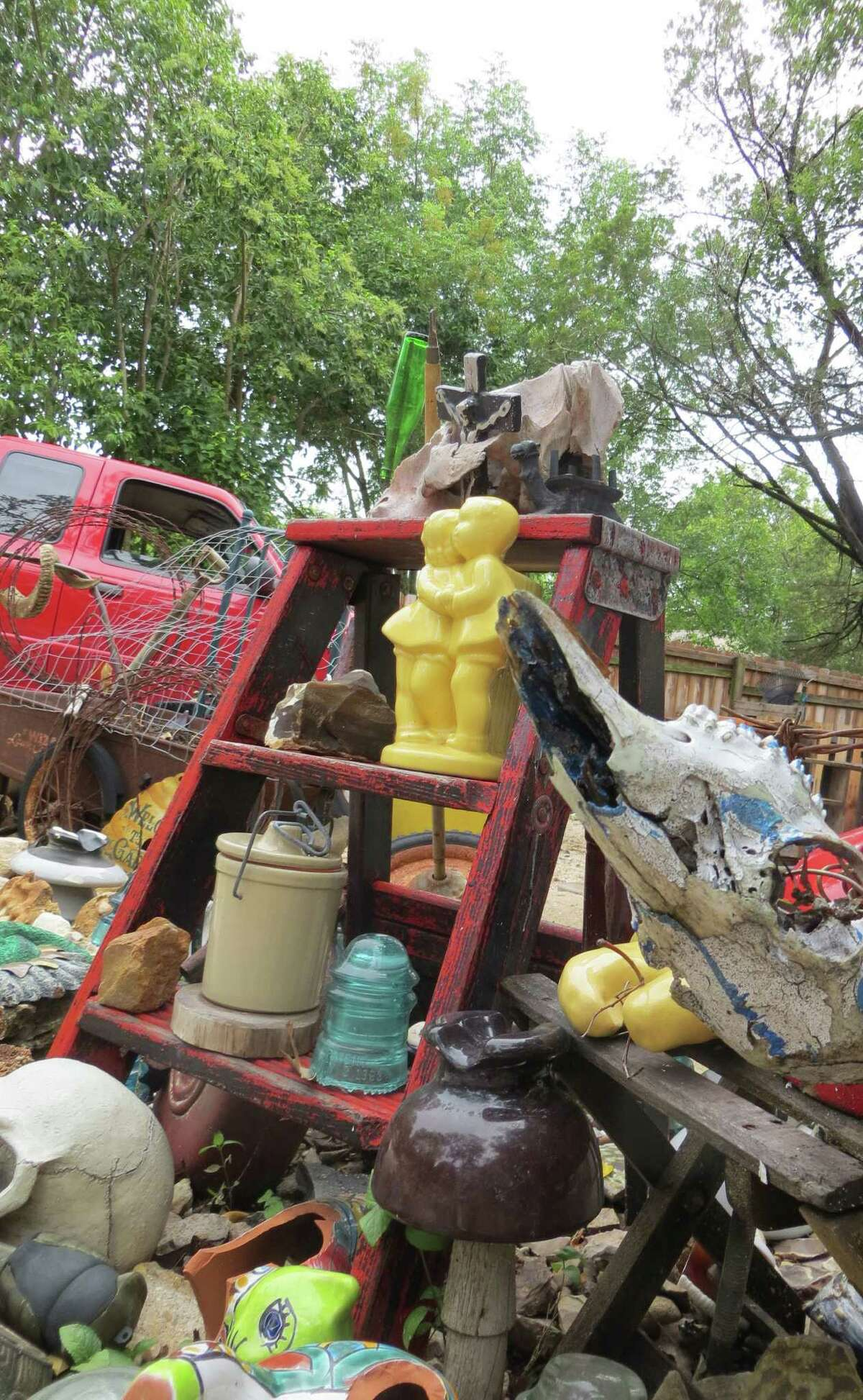 Everything from old furniture to toys and shards of ceramic pottery and old glass insulators can be found on display in front of Renee Lofaso Massey's Alice Street home in Kerrville, much to the dismay of the city