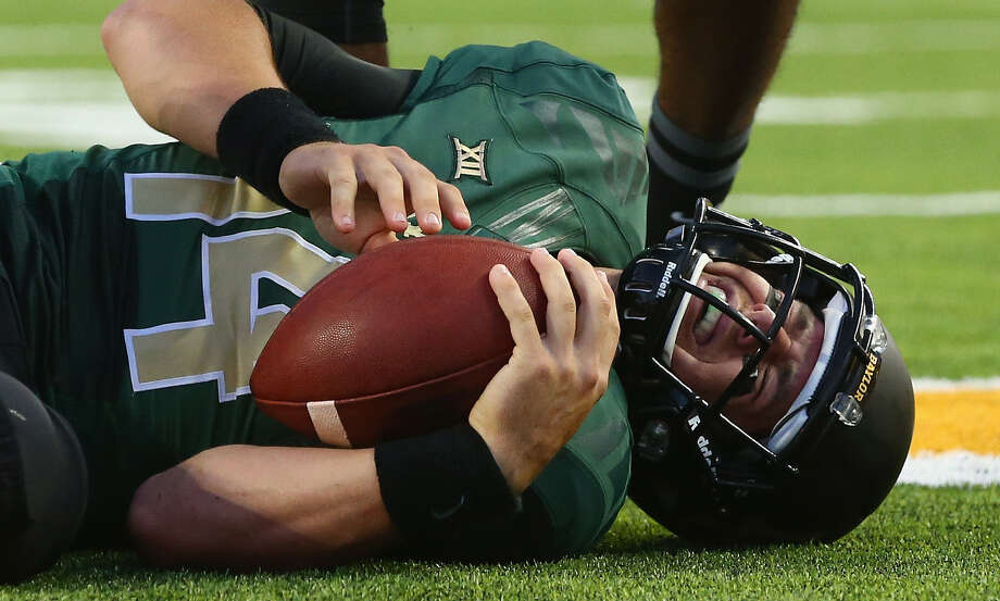 Bryce Petty has two small, cracked bones in his back. Two of his ex-Bears teammates dealt with similar injuries and were OK. Photo: Ronald Martinez / Getty Images / 2014 Getty Images