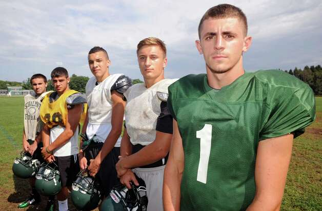 Schalmont High School football team captains, left to right, Anthony Bellini, Nick Gallo, Devin Higgins, Kyle Strobe and Hunter Gal during practice on Tuesday Sept. 2, 2014 in Rotterdam, N.Y. .(Michael P. Farrell/Times Union) Photo: Michael P. Farrell / 00028415A