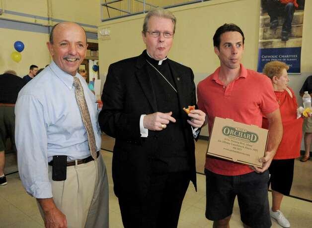 """Left to right, Catholic Charities CEO Vince Colonno, Albany Bishop Edward Scharfenberger and Brendon Noonan of the Orchard Tavern winner of the  during the  """"Bishop's Choice"""" pizza challenge at the Catholic Charities office on Tuesday Sept. 2, 2014 in Rensselaer, N.Y.  (Michael P. Farrell/Times Union) Photo: Michael P. Farrell / 00028430A"""