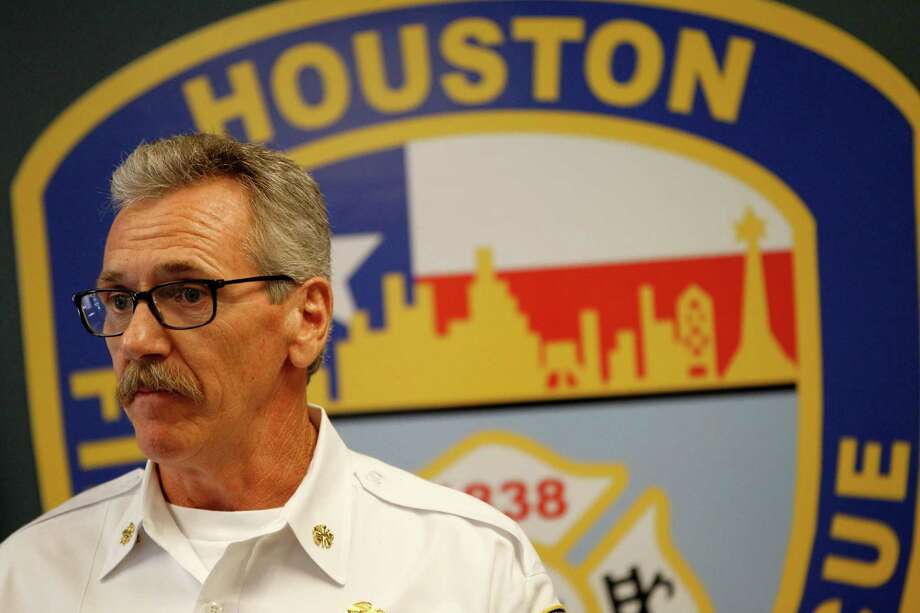 HFD Fire Chief Terry Garrison, at a news conference Tuesday, told reporters the report was not intended to assess blame or determine the cause of the motel fire. Photo: Karen Warren, Staff / © 2014 Houston Chronicle