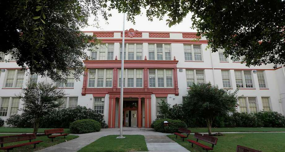 Weeks ago, community leaders protested the demolition of the historic Phyllis Wheatley High School. On Thursday, the HISD school board settled a lawsuit with alumni and Fifth Ward leaders to demolish the school.  Photo: James Nielsen, Staff / © 2014  Houston Chronicle