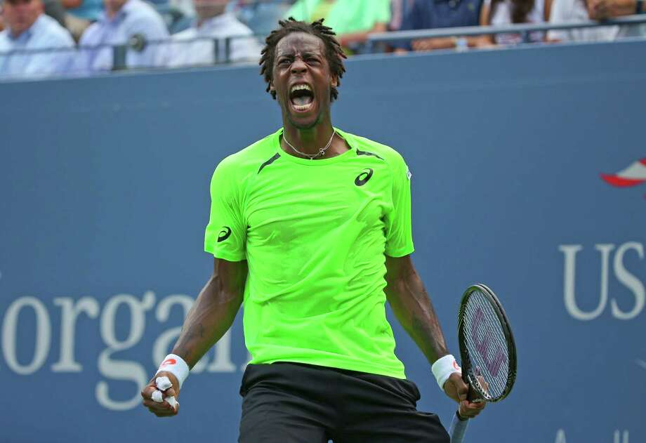 Gael Monfils, of France, reacts after a shot against Grigor Dimitrov, of Bulgaria, during the fourth round of the 2014 U.S. Open tennis tournament, Tuesday, Sept. 2, 2014, in New York. (AP Photo/Mike Groll) ORG XMIT: USO161 Photo: Mike Groll / AP