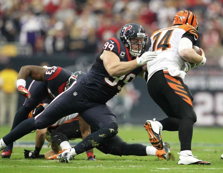 J.J. Watt makes the Bengals' Andy Dalton, right, the victim of one of Watt's sacks. Photo: Karen Warren, Staff / © 2012 Houston Chronicle