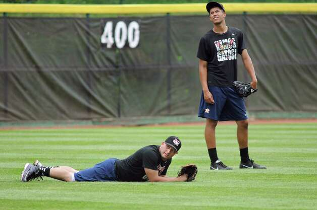 ValleyCats' Jake Rodriguez, left, and Derick Velazquez take a break while shagging balls in the outfield during practice on Tuesday, Sept. 2, 2014, at Bruno Stadium in Troy, N.Y. (Cindy Schultz / Times Union) Photo: Cindy Schultz / 00028413A