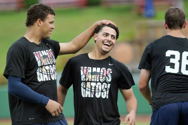 ValleyCats' Alfredo Gonzalez, left, and Alex Hernandez have some fun during practice on Tuesday, Sept. 2, 2014, at Bruno Stadium in Troy, N.Y. (Cindy Schultz / Times Union) Photo: Cindy Schultz / 00028413A