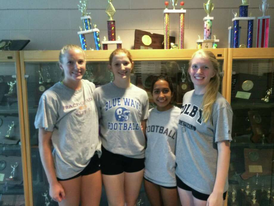 The Darien girls volleyball captains pose before a preseason practice on Thursday, Aug. 28. From left, Izzy Taylor, Claire Naughton, Keli Reyes and Celia Martzolf. Photo: Contributed / Darien News Contributed
