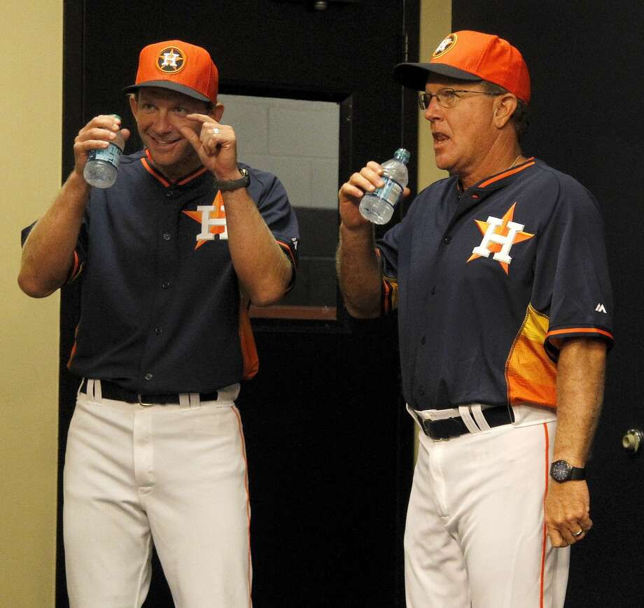 Houston Astros bench coach Adam Everett, left, and interim manager Tom Lawless walk in the door before a press conference at Minute Maid Park. Photo: Karen Warren, Houston Chronicle