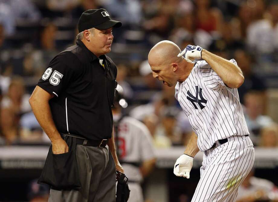NEW YORK, NY - SEPTEMBER 02: Brett Gardner #11 of the New York Yankees argues a called third strike with home plate umpire Tim Timmons #95 and gets thrown out of the game during the fifth inning against the Boston Red Sox in a MLB baseball game at Yankee Stadium on September 2, 2014 in the Bronx borough of New York City. (Photo by Rich Schultz/Getty Images) ORG XMIT: 477589227 Photo: Rich Schultz / 2014 Getty Images