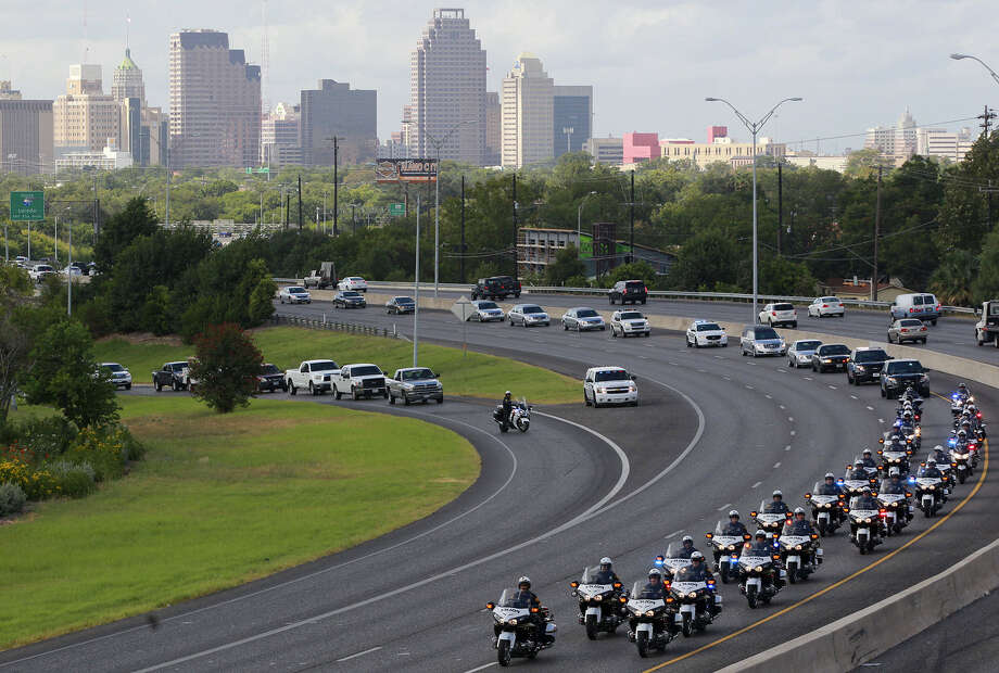 The funeral procession winds its way north on U.S. 281. One of Michael Pimentel's favorite hobbies was riding his Harley. Photo: John Davenport / San Antonio Express-News / ©San Antonio Express-News/John Davenport