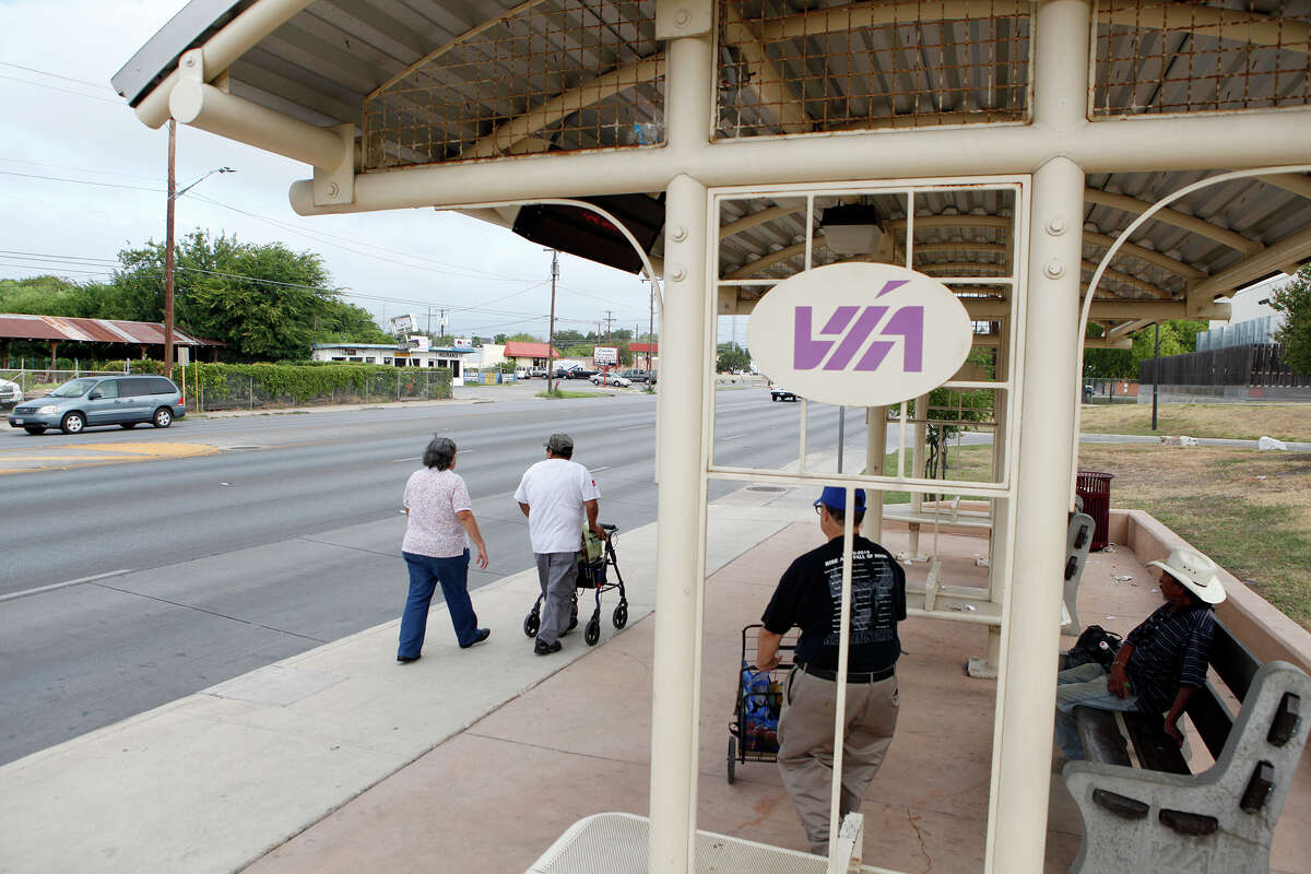 People walk by and walk to one one of the VIA stops on South Zarzamora Street Friday, Aug. 29, 2014. VIA is proposing to spend the $92 million from the Texas Department of Transportation, that was slated to go to the rail project, on adding bus rapid transit service on the southwest side, which could include parts of Zarzamora, from SW Military to Fredericksburg Road, or General McMullen, from Castroville Road to Babcock. VIA could also spend it on a number of park and ride and transit center projects.