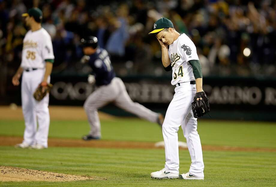 OAKLAND, CA - SEPTEMBER 02:  Sonny Gray #54 of the Oakland Athletics reacts as Kyle Seager #15 of the Seattle Mariners rounds first base after hitting a home run in the fifth inning at O.co Coliseum on September 2, 2014 in Oakland, California.  (Photo by Ezra Shaw/Getty Images) Photo: Ezra Shaw, Getty Images