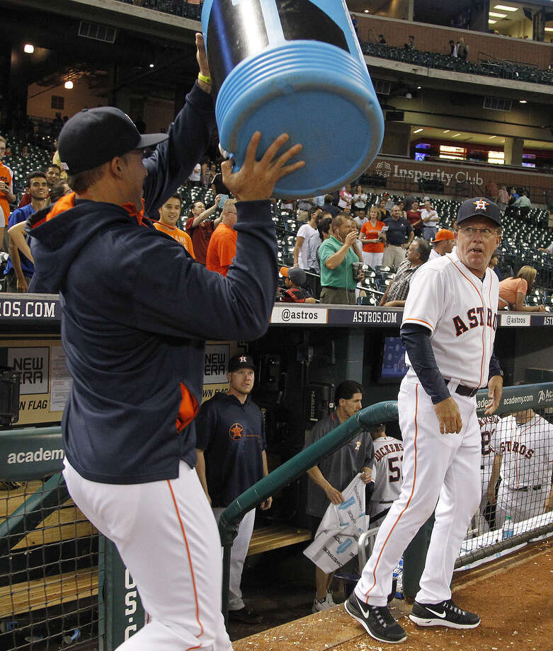 Astros interim manager Tom Lawless (right) looks to avoid a celebratory bucket of ice water held by George Springer after Houston won its first game following the firing of Bo Porter. Photo: Karen Warren / Houston Chronicle / © 2014 Houston Chronicle