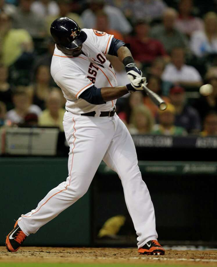 Houston Astros Chris Carter lines out to Oakland Athletics left fielder Jonny Gomes during the third inning at Minute Maid Park Tuesday, Aug. 26, 2014, in Houston. ( Melissa Phillip / Houston Chronicle ) Photo: Houston Chronicle / © 2014  Houston Chronicle