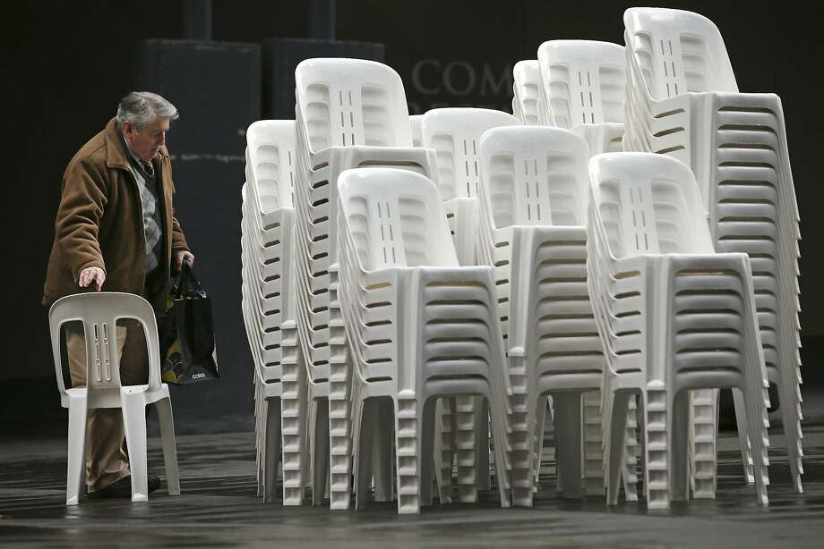 I like this, but the one on top of the third stack is really special: John Bowers has many choices for seating in Sydney's Martin Place. Photo: Rick Rycroft, Associated Press