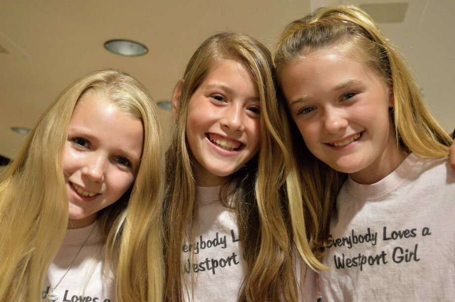 Sutton Lindau, Sydney Newman and Clara Holleman, all 11, were honored at Tuesday's session of the Representative Town Meeting for a video they made promoting the town's appeal, which helped Westport win a state tourism contest. Photo: Jarret Liotta / Westport News