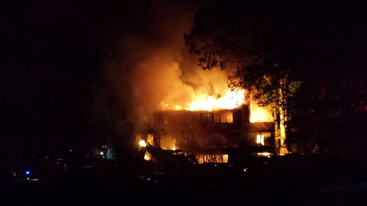 Fire rips through a North Stamford House at 25 Bittersweet Lane early Wednesday, Sept. 3, 2014.
