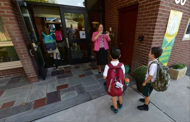 Principal Theresa Ewell makes photos of students on the first day of class at Mater Christi School in Albany. (Skip Dickstein / Times Union)