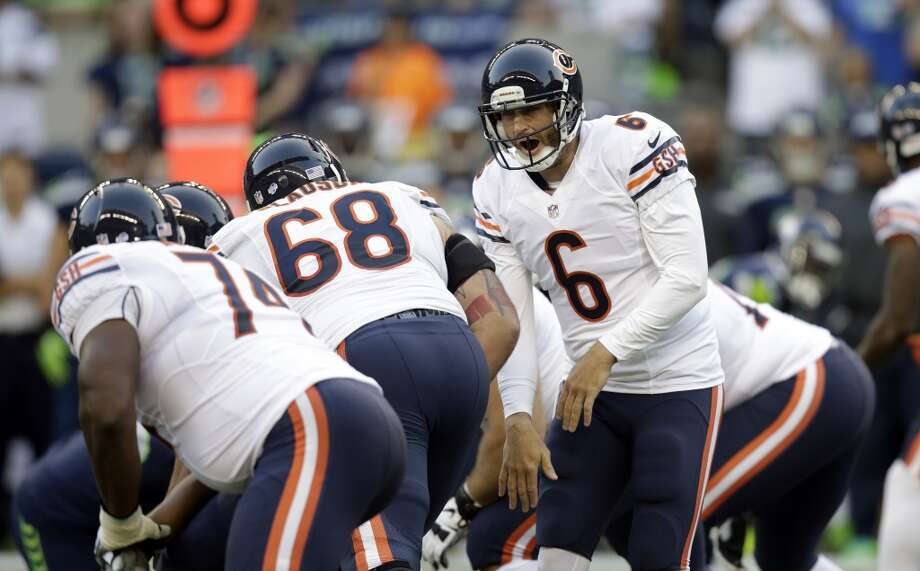 16. Chicago (Last year: 8-8):   With receivers Brandon Marshall and Alshon Jeffrey, Jay Cutler might throw for 5,000 yards if he can remain healthy for an entire season. Photo: Stephen Brashear, Associated Press