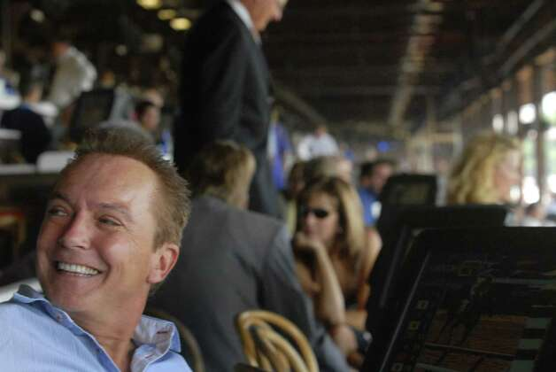 TIMES UNION STAFF PHOTO--MICHAEL P. FARRELL--Saratoga Springs , New York 7/25/2007--Horse owner and television star David Cassidy smiles in his box on the first day of the 2007 season at the Saratoga Race Course. ORG XMIT: MER2013082111582478 Photo: MICHAEL P. FARRELL / ALBANY TIMES UNION