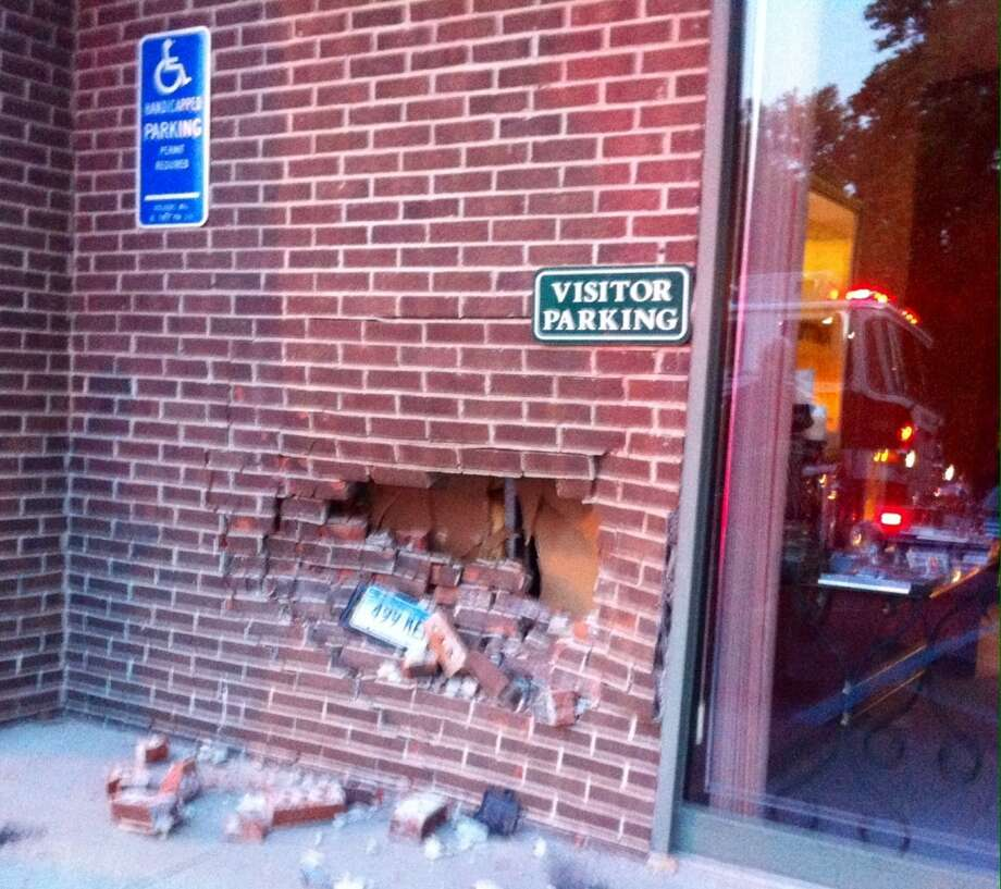 A 93-year-old New Fairfield woman on her way to a ballroom dance class jumped the curb with her car and slammed into the brick exterior wall of the studio before throwing the car into reverse and crashing it into the building for a second time. Photo: Rob Ryser
