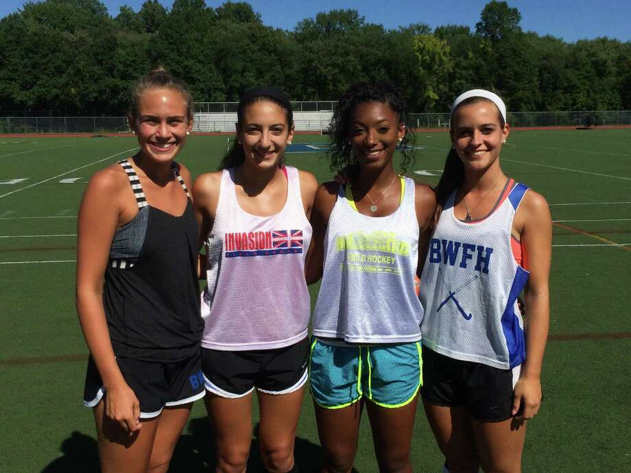 The 2014 Darien field hockey captains pose before a preseason practice on Friday, Aug. 29. From left, Mary Brown, Rebecca DeMaio, Kyla Johns and Julia Russo. Photo: Contributed / Darien News Contributed