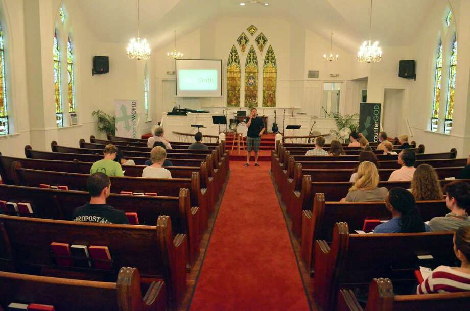 Pastor Landon Reesor leads Encounter's services on Sunday, August 31 in the Calvary Baptist church. Photo: Megan Spicer / Darien News