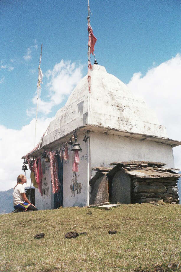 Elizabeth Schimenti next to a devotional temple at the peak of a mountain in the Himalaya, India, where she spent two months taking a wilderness training course in spring 2014. Photo: Contributed Photo, Contributed / New Canaan News Contributed