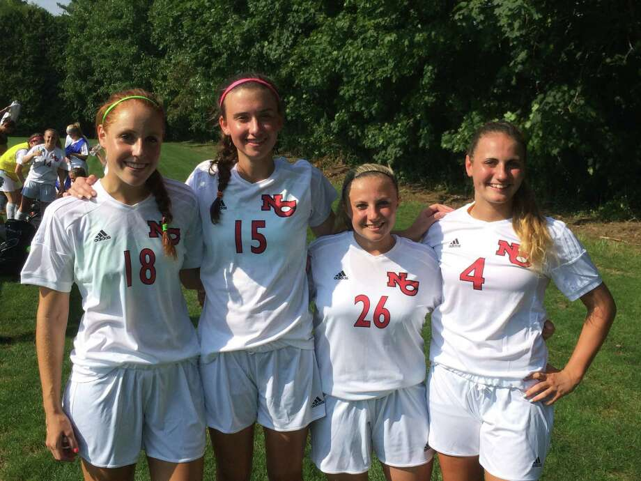 The 2014 New Canaan girls soccer captains pose before a preseasons crimmage on Tuesday, September 3, at Connor Field in New Canaan. From left, Kyla Persky, Gabriella Borea, Courtney Overacker and Marina Braccio. Photo: Andrew Callahan / New Canaan News