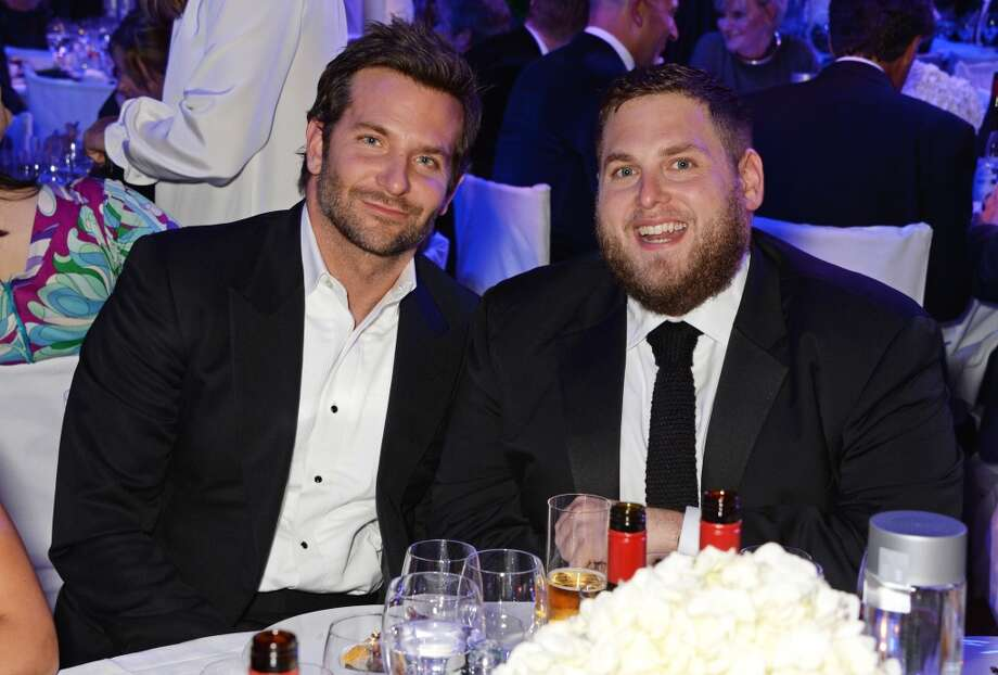 Bradley Cooper (L) and Jonah Hill attend the GQ Men Of The Year awards in association with Hugo Boss at The Royal Opera House on September 2, 2014 in London, England. Photo: David M. Benett, Getty Images