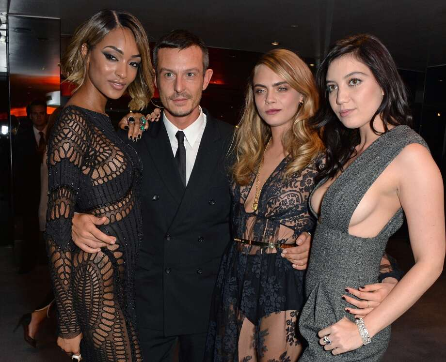 (L to R) Jourdan Dunn, Jonathan Saunders, Cara Delevingne and Daisy Lowe attend the GQ Men Of The Year awards in association with Hugo Boss at The Royal Opera House on September 2, 2014 in London, England. Photo: David M. Benett, Getty Images
