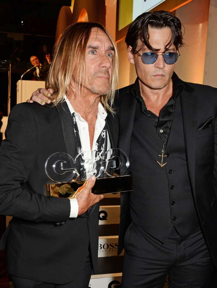 Iggy Pop (L), winner of the Icon Award, and presenter Johnny Depp attend the GQ Men Of The Year awards in association with Hugo Boss at The Royal Opera House on September 2, 2014 in London, England. Photo: David M. Benett, Getty Images
