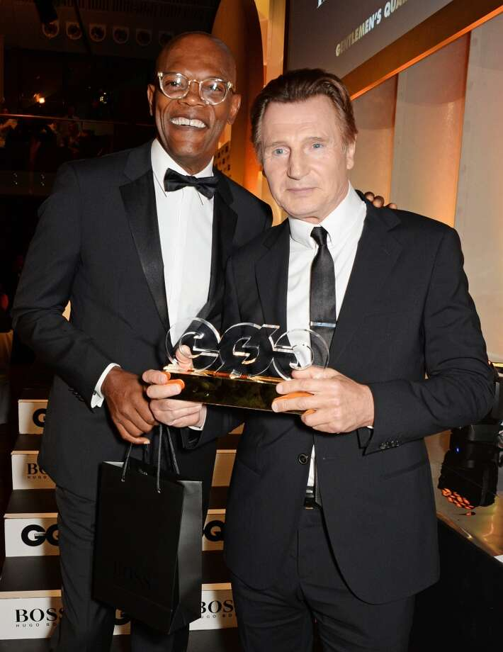 Presenter Samuel L. Jackson (L) and Liam Neeson, winner of the Editor's Special Award, attend the GQ Men Of The Year awards in association with Hugo Boss at The Royal Opera House on September 2, 2014 in London, England. Photo: David M. Benett, Getty Images