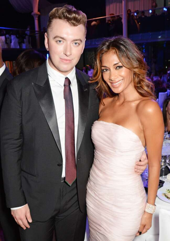 Sam Smith (L) and Nicole Scherzinger attend the GQ Men Of The Year awards in association with Hugo Boss at The Royal Opera House on September 2, 2014 in London, England. Photo: David M. Benett, Getty Images