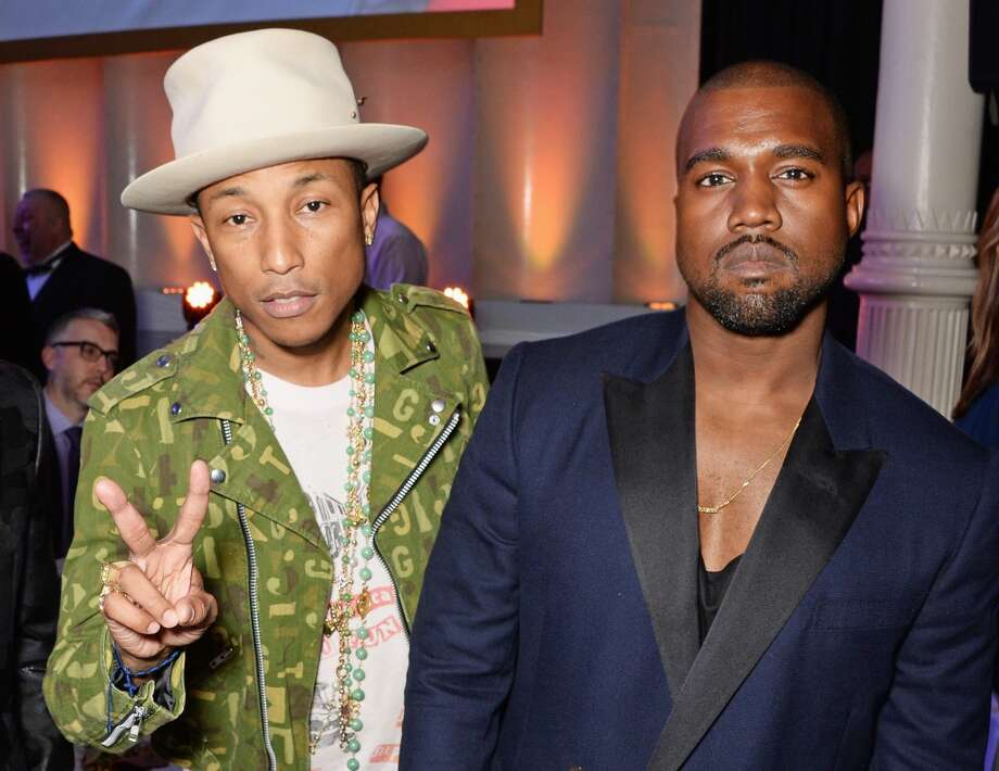 Pharrell Williams (L) and Kanye West attend the GQ Men Of The Year awards in association with Hugo Boss at The Royal Opera House on September 2, 2014 in London, England. Photo: David M. Benett, Getty Images