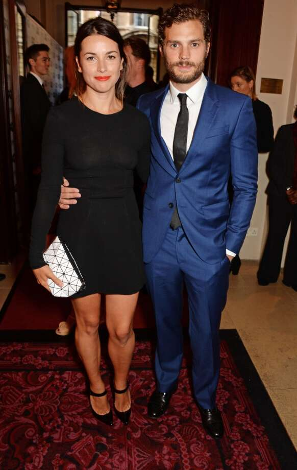 Amelia Warner (L) and Jamie Dornan attend the GQ Men Of The Year awards in association with Hugo Boss at The Royal Opera House on September 2, 2014 in London, England. Photo: David M. Benett, Getty Images