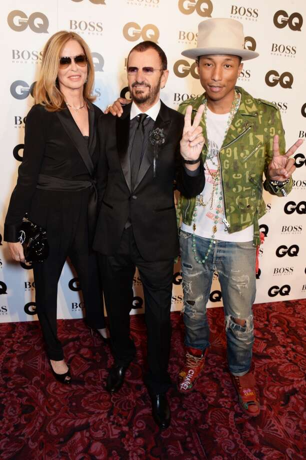 (L to R) Barbara Bach, Ringo Starr and Pharrell Williams attend the GQ Men Of The Year awards in association with Hugo Boss at The Royal Opera House on September 2, 2014 in London, England. Photo: David M. Benett, Getty Images