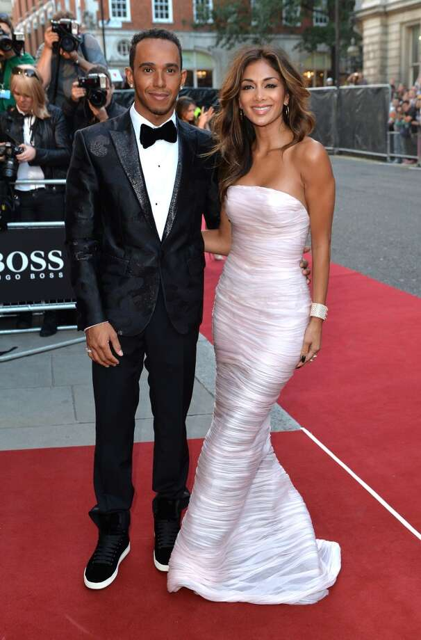 Lewis Hamilton and Nicole Scherzinger attend the GQ Men of the Year awards at The Royal Opera House on September 2, 2014 in London, England. Photo: Anthony Harvey, Getty Images
