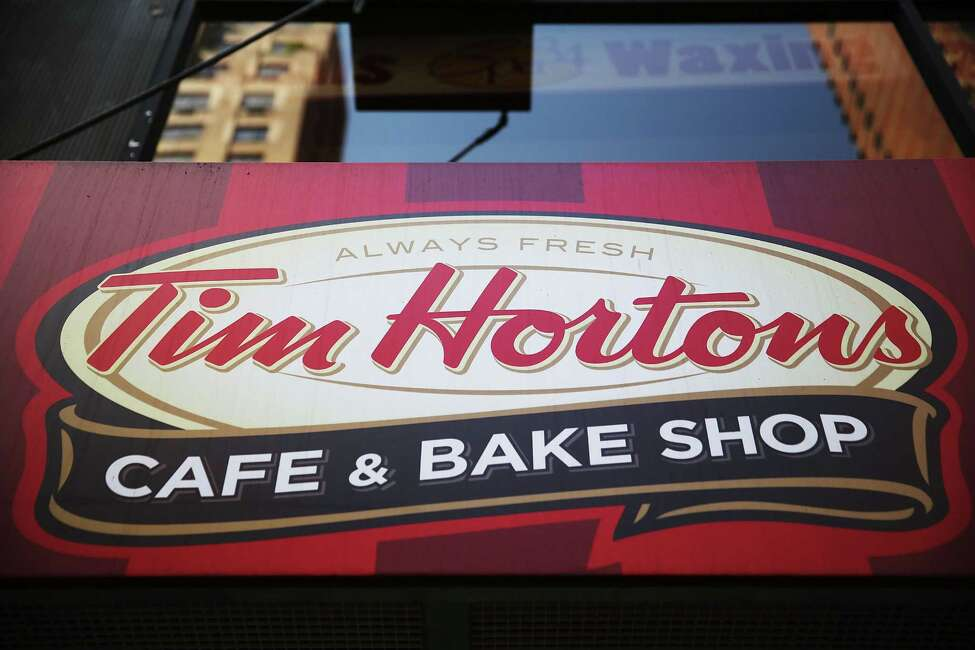 Tim Hortons sign from a shop in New York City. A child died in Rochester Monday after falling into a grease trap behind a Tim Hortons in Rochester. (Photo by Spencer Platt/Getty Images) ORG XMIT: MER2014082513423400