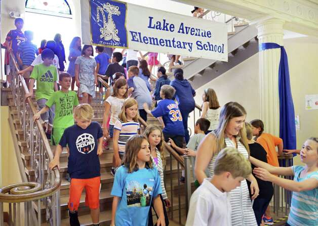 Students fill the hallways on their first day back to school at Lake Avenue Elementary School Wednesday Sept. 3, 2014, in Saratoga Springs, NY.  (John Carl D'Annibale / Times Union) Photo: John Carl D'Annibale / 00028428A