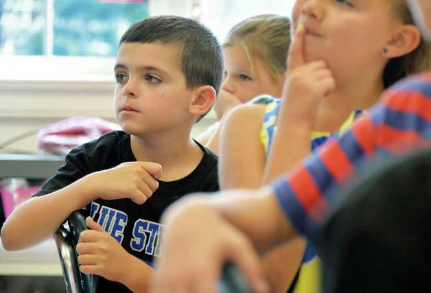 Second grader Matthew Leonard in class on the first day back to school at Lake Avenue Elementary School Wednesday Sept. 3, 2014, in Saratoga Springs, NY.  (John Carl D'Annibale / Times Union) Photo: John Carl D'Annibale / 00028428A