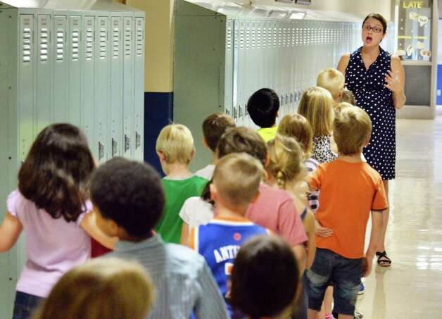 First grade teacher Stephanie Barrows, right, leads students on a tour on the first day back to school at Lake Avenue Elementary School Wednesday Sept. 3, 2014, in Saratoga Springs, NY.  (John Carl D'Annibale / Times Union) Photo: John Carl D'Annibale / 00028428A