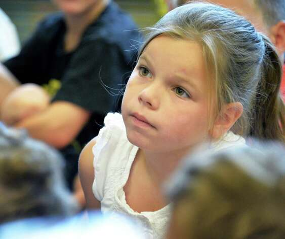 Second grader Ellie Richardson listens to her teacher's instructions on the first day back to school at Lake Avenue Elementary School Wednesday Sept. 3, 2014, in Saratoga Springs, NY.  (John Carl D'Annibale / Times Union) Photo: John Carl D'Annibale / 00028428A