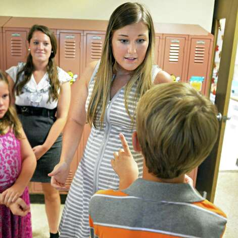 Fourth grade teacher Jenn O'Leary, center, answers a student's questions on the first day back to school at Lake Avenue Elementary School Wednesday Sept. 3, 2014, in Saratoga Springs, NY.  (John Carl D'Annibale / Times Union) Photo: John Carl D'Annibale / 00028428A